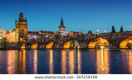 Prague ,view of the Lesser Bridge Tower of Charles Bridge (Karluv Most) at dusk, Czech Republic.