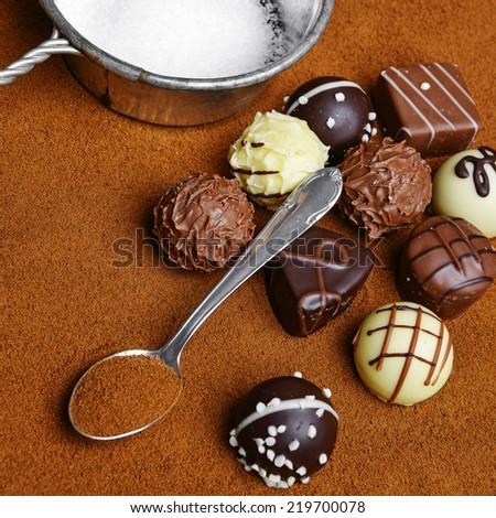 pralines and chocolate background - stock photo