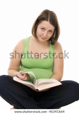 pregnant woman reads the book