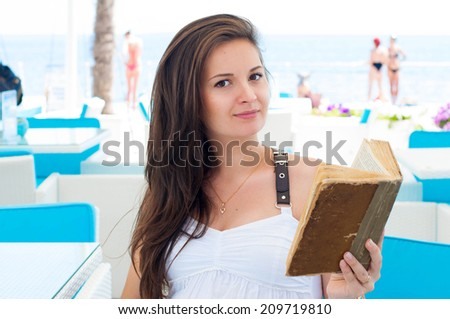 Pregnant Woman with a book  - stock photo