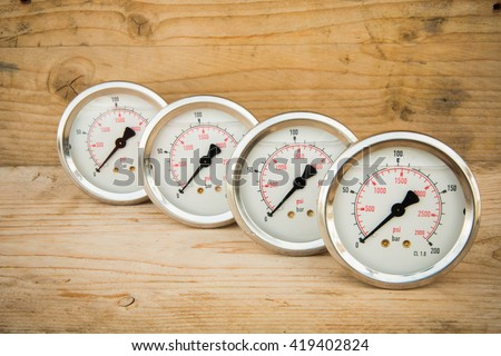 Pressure gauge or damage pressure gauge of oil and gas industry on wooden background, Equipment of production proces