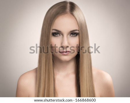 Pretty blonde with perfect straight long glossy hair. - stock photo