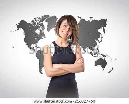 Pretty woman with hers arms crossed over atlas background  - stock photo