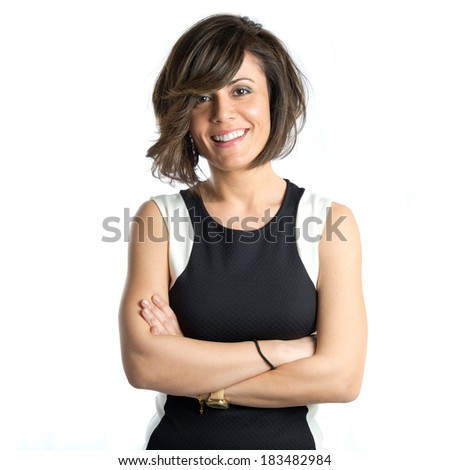 Pretty woman with hers arms crossed over white background  - stock photo