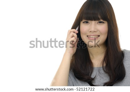 Pretty young lady with long hair talking on mobile phone and smiling.