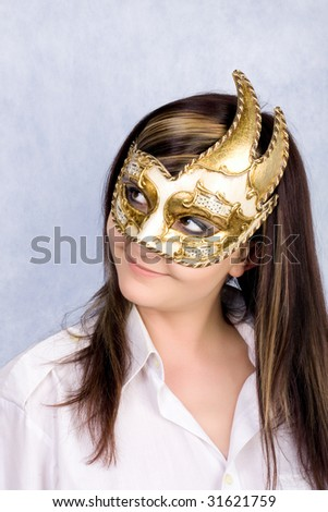 Pretty young woman in Carnival Venetian mask