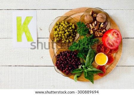 ... , parsley, basil, egg yolk, dried apricots, tomatoes - stock photo