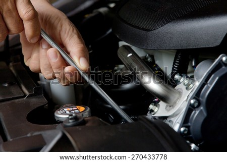 Professional car mechanic, auto repair concept - stock photo
