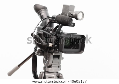 Professional digital video camera, isolated on white background - stock photo