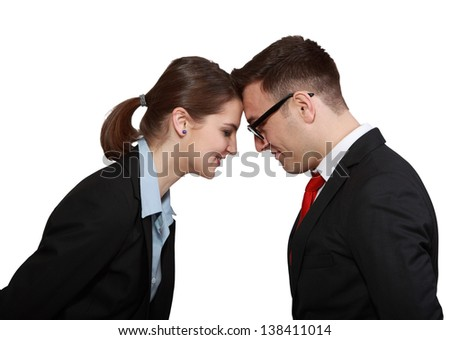 Profile of a happy business couple head in head isolated against a white background. - stock photo
