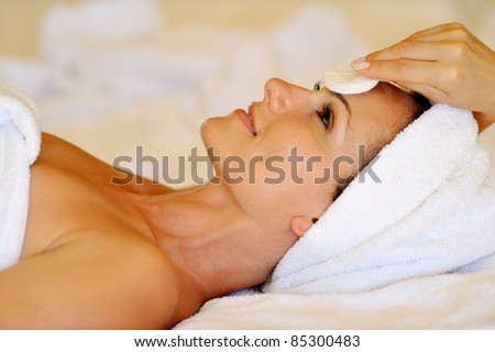 profile view of happy young woman preparing for cosmetic treatment