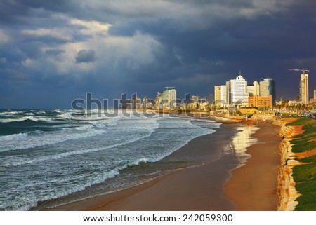 Promenade and beach in Tel Aviv. Storm at sunset in the Mediterranean - stock photo