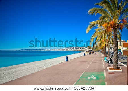 Promenade des Anglais in Nice, France. Nice is a popular Mediterranean tourist destination, attracting 4 million visitors each year. - stock photo