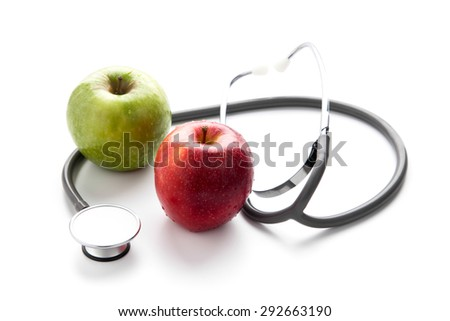Protect your health with healthy nutrition: Stethoscope and apple    - stock photo