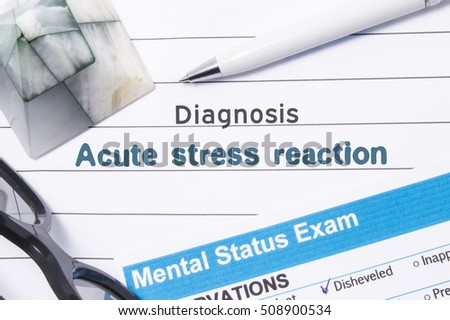 Psychiatric Diagnosis Acute Stress Reaction. Medical book or form with the name of diagnosis Acute Stress Reaction is on table of doctor surrounded by questionnaire to determine mental state