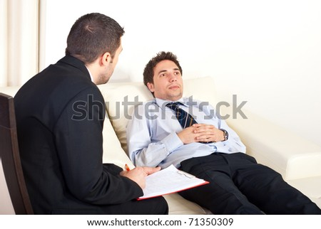 Psychiatrist man talking  with hypnotized male patient