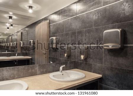 \public bathroom in gray colors - stock photo