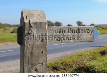 """Public Bridleway, Knaplock 1"" Wooden Sign Post on a Circular walk near Tarr Steps within Exmoor National Park, Somerset, England, UK - stock photo"