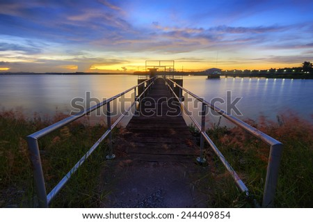 pumping stations, reservoirs Tricks with light and clouds flowing. - stock photo