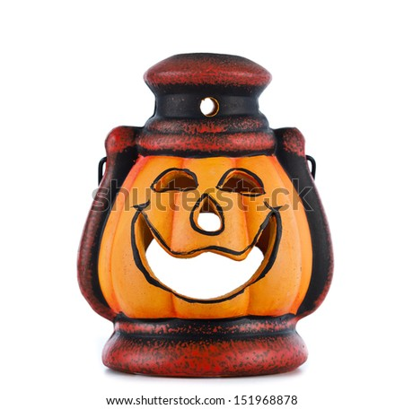 pumpkin lantern with candle inside lit on white background - stock photo
