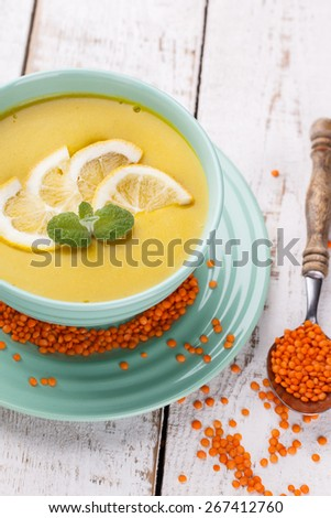 Puree soup with red lentils,with mint and lemon wedges.Traditional Turkish cuisine. - stock photo