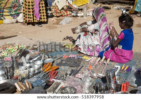 pushkar fair / india 9 november 2016  household utensils shop on street  at the Pushkar annual camel fair market Rajasthan  India