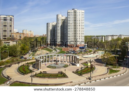 PUSHKINO, RUSSIA - on MAY 7, 2015. View of the Memorial and new multystoried house