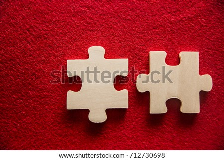 2 puzzle.Two wooden part on table red texture background. idea, sign, symbol, concept of true romantic passion, couple in love, sex. happy valentine's day