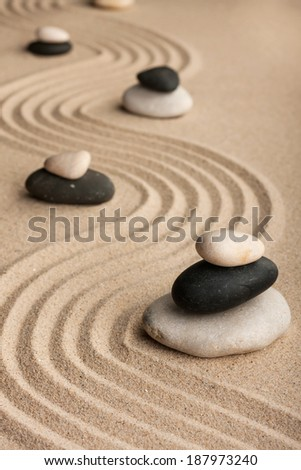 Pyramids  made of  stones standing on the sand, as background
