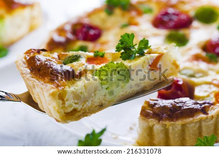 quiche with broccoli, cauliflower, carrots and tomatoes - stock photo