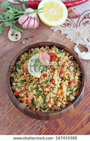 Quinoa salad with vegetables mix, herbs and lemon. - stock photo