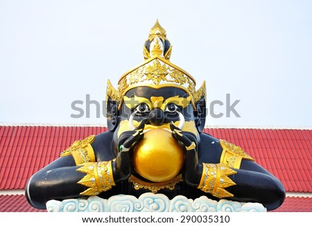 """""""RAHOO"""" luna eclipse god in the myth with black half giant body and full moon in mouth,Wat Samarn,Chacheangchao,Thailand. - stock photo"""