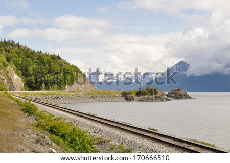 Railroad tracks running through Turnagain Arm, Alaska  - stock photo
