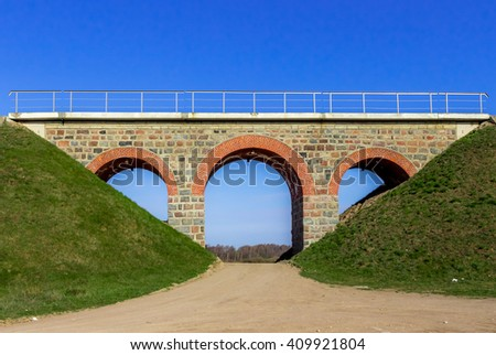 Railway bridge of brick with arches