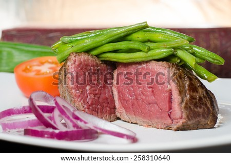 rare beef steak with beans - stock photo