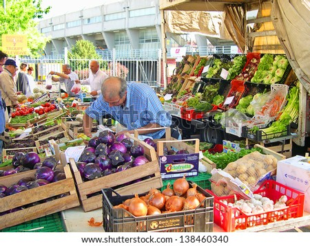 RAVENNA, ITALY MAY 21: vegetables vendor at the Wednesday outdoor market. The place is very popular in the city and attracts thousands of people. May 21, 2005 Ravenna Italy