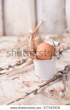 raw eggs in a nest of hay and grass .