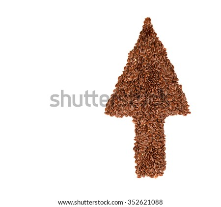 Raw flax seeds linseed arrow shaped on white background. Diet healthcare healthy food.  - stock photo