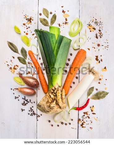raw vegetables Set of herbs and spices, ingredient for  broth or soup on white wooden table , food background , top view - stock photo