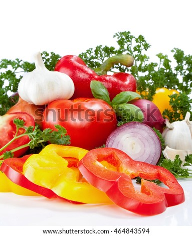 raw vegetables with green leaves , isolated on a white background