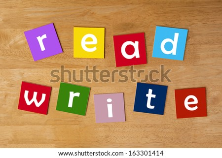 read, write - word sign for school children - lower case letters for education & learning. - stock photo