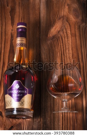 READING ENGLAND MARCH. 19. 2016 Courvoisier V.S.O.P. (very superior old pale) Cognac bottle and box against wood. It is a luxury brand of French cognac established by Felix Courvoisier in 1835.