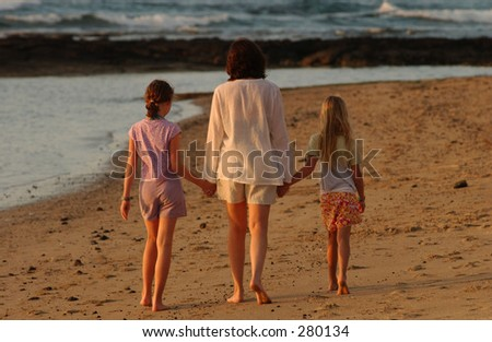 """Rear view of a mother and her two daughters walking on the beach, Hawaii,  (Keith Levit)"""