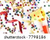 red and golden spirals, small confetti stars and yellow dotted blower on white background, party time - stock photo