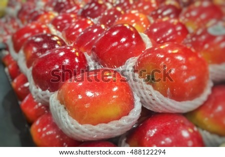Red Apple Is wrapped with a sponge cushioning