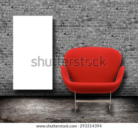 red armchair in grey interior and white mockup over brick wall - stock photo