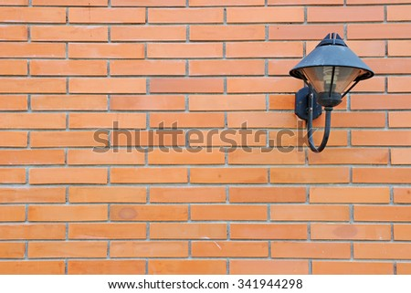 red brick wall and lamp - stock photo