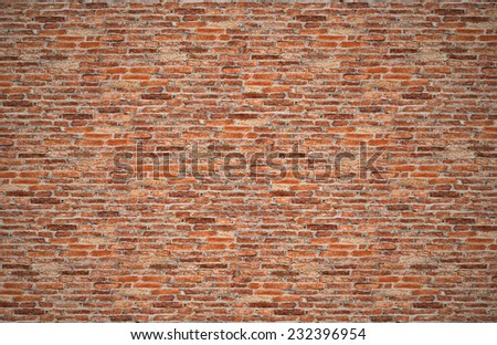 red brick wall or old dark brown, orange brick fences, grungy rusty blocks of stone work for texture and background  - stock photo