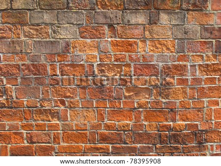 Red brickwork as a grunge wallpaper background - stock photo