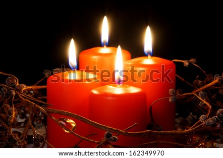 4 red candles as christmas decoration